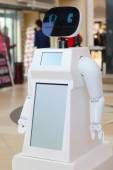 White promo robot with black face in big mall. Shallow dof — Stock Photo