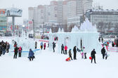 PERM, RUSSIA - JAN 1, 2014: People in Ice town at snowy day. Con — Stock Photo