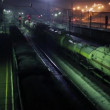 Three long freight trains move on railway at winter night — Stock Video #76411851