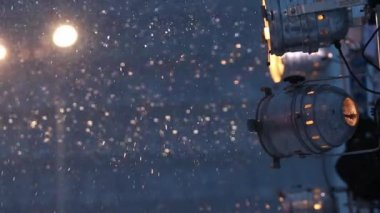 Lantern and spotlights during snowfall at winter night — Stock Video