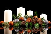 Christmas candles on a black background — Stock Photo