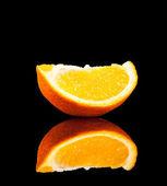 Orange fruit isolated on a black background — Stock Photo
