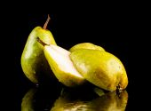 Juicy flavorful pears on a black background — Stock Photo