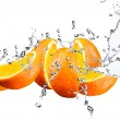 Orange fruits and Splashing water — Stock Photo #64697065