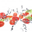 Salad with tomatoes isolated on white background and Splashing water — Stock Photo #72166577