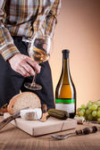 Bottle of white wine and grapes on a wooden table — Stock Photo