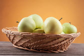 Summer green apple on the wooden table — Stock Photo