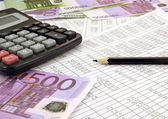 Money with calculator — Stock Photo