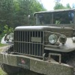 """American old car Dodge WC-51 near field road, 3rd international meeting """"Motors of war"""" near the city Chernogolovka, Moscow region, a fragment of the front of the — Stock Photo #54914229"""
