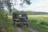"""American military Dodge WC-51 on retro rally on forest road, 3rd international meeting """"Motors of war"""" near the city Chernogolovka, Moscow region — Stock Photo"""