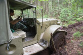 """U.S. army Dodge WC-51 stuck in the woods on a heavy road, 3rd international meeting """"Motors of war"""" near the city Chernogolovka, fragment — Stock Photo"""