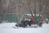 Children skating on a snowmobile in the Park Northern Tushino — Stock Photo