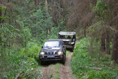 """Toyota Land Cruiser towed at forest road retro car Dodge WC-5,  3rd international meeting """"Motors of war"""" near the town of Chernogolovka, Moscow region — Stock Photo"""