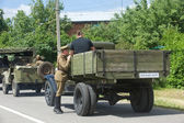 "Old truck in a convoy of military retro cars on the road, the 3rd international meeting of ""Motors of war"" near the city Chernogolovka, Moscow region — Stock Photo"