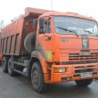 Orange dump truck KAMAZ enters into a snow melting point in Moscow — Stock Photo #64994295