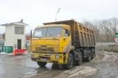 Dump truck KAMAZ about negotable on snow-melting point, Moscow — Stok fotoğraf