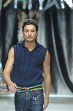 Moscow Fashion Week in Gostiny Dvor. Russian singer Dima Bilan at the show of fashion designer Shiyan