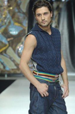 Moscow Fashion Week in Gostiny Dvor. Russian singer Dima Bilan at the show of fashion Shiyan