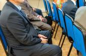 People sitting at the business conference close up side view — Stock Photo