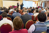 People sitting rear at the business conference — Stock Photo