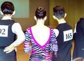 Ballroom dancers standing in a row rear view — Stock Photo