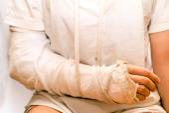 Medicine bandage on injury elbow — Stock Photo