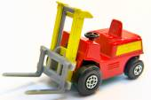 Red and yellow industrial fork lift loader truck toy isolated on white — Stock Photo
