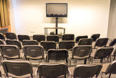 Screen in empty conference hall — Stock Photo
