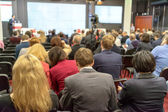 The audience listens to the acting in a conference hall — Stock Photo