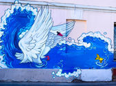 Swan and a fish - graffiti on the wall made by unknown artist in Chistiye ponds street. Illustration of an 1831 poem by Aleksandr Pushkin The Tale of Tsar Saltan - Beautiful Princess-Swan. — Stock Photo