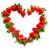 Red strawberry heart shape isolated on white background, symbol of love and passion — Stock Photo