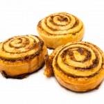 Three fresh sweet homemade cinnamon rolls isolated on white background — Stock Photo #71115505