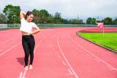 Female athlete warm up in stadium arena and race running track t — Stock Photo