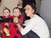 Asian mother with her twins children baby at christmas — Stok fotoğraf