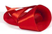 Roll of Unfolding Shiny Red Silk Ribbon — Stock Photo