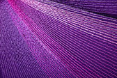 Intricate Colorful Stitching Forming Pattern on Mauve Fabric — 图库照片