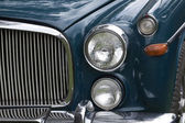 Closeup of Chrome Grille and Lights of Restored Classic Car — Stock Photo