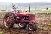 Red Restored Vintage Tractor Ploughing Agricultural Field — Stock Photo