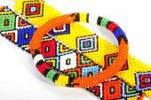 Circular Beaded Zulu Armband Atop Two Wristbands — Stock Photo