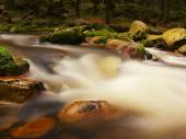 Big boulders in foamy water of mountain river in forest. Light blurred water with reflections. — Stock Photo