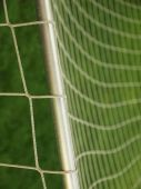 Hang bended soccer nets, soccer football net. Grass on football playground in the background — Stock Photo