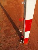 Detail of gate frame . Outdoor football or handball playground, light red crushed bricks surface on ground — Stock Photo