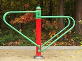 Empty new painted seesaw on a playground, new design of equipment for kindergarden — Stock Photo