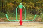 Empty new painted seesaw on a playground, new design of equipment for kindergarden — Stockfoto