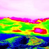 Fantastic infrared scan of rocky  landscape, pine forest with colorful fog, hot sunny sky above. Grunge background in thermography colors. — Stock Photo