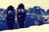 Snowshoes in snow at mountain peak, nice sunny winter day — Stock Photo