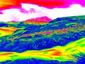Rapid stream in mountains in infrared photo. Amazing thermography. Hilly landscape in background. — Stock Photo