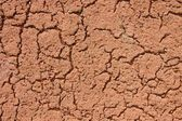 Old dry red crushed bricks surface on outdoor tennis ground. Detail of texture — Stock Photo