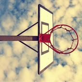 Old neglect basketball backboard with rusty hoop above street court. Blue cloudy sky in bckground. Retro filter — Stock Photo