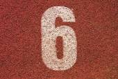 White track number on red rubber racetrack, texture of running racetracks in small outdoor stadium — Stockfoto